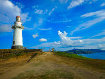 Lighthouse by the cliff Stock Images