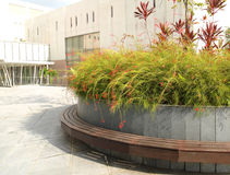 Landscaping, city offices area. A photograph showing the style and design of some landscaped areas around modern office architecture.  Round planter boxes with Royalty Free Stock Image