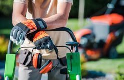 Landscaping Contractor Work. Caucasian Gardener with His Equipment royalty free stock photography