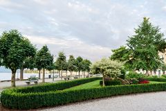 Landscaping of the embankment of the city with trimmed trees, shrubs and flower beds.  royalty free stock photo