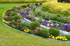 Landscaping with flowers and bushes. Park Royalty Free Stock Photo