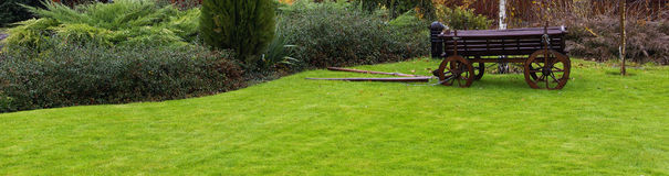 Landscaping in the garden. Peaceful Garden with a Freshly Mown Lawn stock photos