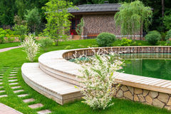 Landscaping in home garden. Natural landscaping in home garden royalty free stock photo