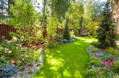 Free Landscaping In Green Home Garden. Landscape Design With Plants And Flowers At Residential House. Scenic View Of Nice Landscaped Royalty Free Stock Image - 167796296