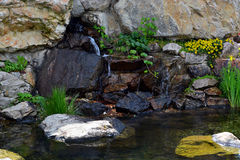 Landscaping pond. A lovely corner in this garden after some great landscaping work stock image
