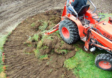 Tractor emoving turf Stock Photo