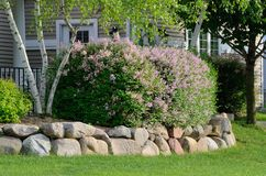 Landscaping and Rock Retaining Wall Stock Photo