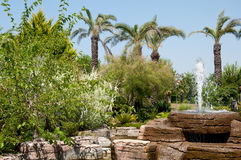 Landscaping -  stone fountain and pond Stock Photo