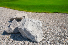 Landscaping. Stones on gravel and lawn royalty free stock image