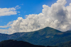A landscaping symmetry of mountains and clouds Stock Photo