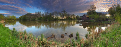 Landscepe da mola com watermill - panorama Imagem de Stock Royalty Free