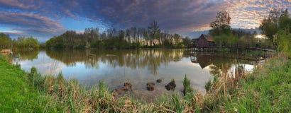 Landscepe del resorte con el watermill - panorama Imagen de archivo libre de regalías