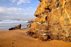 Landschaft des Strandes und des Steins Lizenzfreies Stockbild