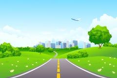 Landschaft - grüne Hügel mit Baum und Stadtbild Lizenzfreies Stockfoto
