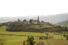 Landschaft mit Bergen und Kirche Lizenzfreies Stockfoto