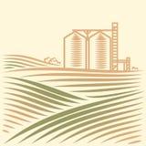 Landschaft mit einem Getreideheber Stockfotos