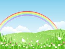 Landschaft mit einem Regenbogen. Lizenzfreies Stockfoto