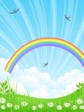 Landschaft mit einem Regenbogen. Stockfotografie