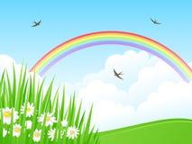 Landschaft mit einem Regenbogen. Stockfotos