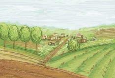 Landschaft mit Feldern und Dorf Stockfoto