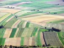 Landschaft mit kleinen Feldern Lizenzfreie Stockfotos