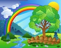 Landschaft mit Regenbogen und Baum Lizenzfreie Stockbilder