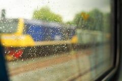 Landschaft vom Zugfenster nach dem Regen Lizenzfreies Stockbild