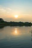 Landschaftsansicht mit Sonnenuntergangzeiten Stockfotos