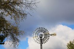Landschaftspark Duisburg, Germany: Close up of isolated wind wheel against blue sky and clouds royalty free stock images