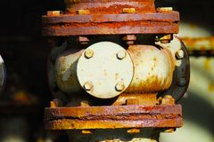 Landschaftspark Duisburg, Germany: Close up of rusty corroded tube construction with valves. Close up of rusty corroded tube construction with valves stock photo