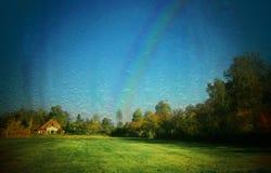 Landschap met regenboog Stock Foto