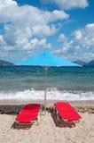 Landschap met strand en parasols Stock Foto's