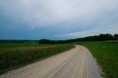 Landscpae аграрного края с вырезыванием дороги до конца в Sout Стоковое Фото
