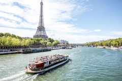 Landscape view of Paris. Landscpae view on the Eiffel tower and Seine river with tourist boat in Paris Royalty Free Stock Image