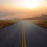 Landshuvudväg och solnedgång Royaltyfria Foton