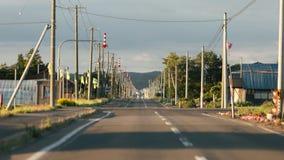 Landskap av bygdvägen i Hokkaido, Japan i magisk timme fotografering för bildbyråer