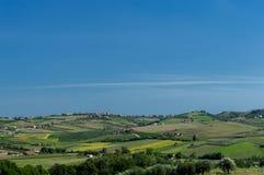 Landskap av ett åkerbrukt land Arkivbild