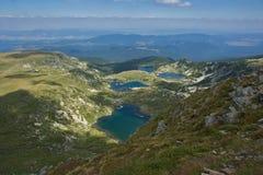 Landskap av fisken, det lägre, de tvilling- och Trefoil sjöarna, de sju Rila sjöarna, Bulgarien Arkivfoto