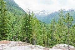 Landskap för högt berg med tunga regniga moln Fotografering för Bildbyråer