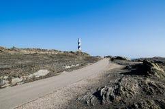 Landskap fotografi av ett av de bästa bekanta ställena i Menorca på kusten med en fyr royaltyfria foton