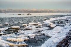 Landskap i solnedgången med packad is i havet Royaltyfria Foton