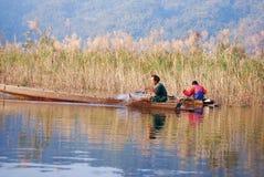 Landskap med en fiskare Arkivbild