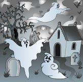 Landskap på kyrkogård med spökar 2 Arkivbild