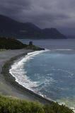 Landskap: Strand och torn i Korsika Arkivfoto