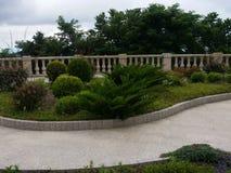 Landskapdesignträdgård på kloster Batumi, Georgia för helig Treenighet Royaltyfria Bilder