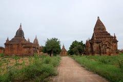 Landskapet av gamla tempel (stupas) i Bagan, Myanmar Arkivbild
