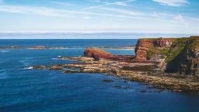 Landskapet av havsfjärden och vaggar, den Oxroad fjärden Arkivbilder