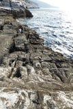 Landskapet med vatten och vaggar i den Thassos ön, Grekland Fotografering för Bildbyråer