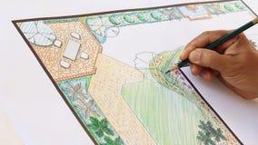 Landskapsarkitektdesign L formträdgårdplan arkivfilmer