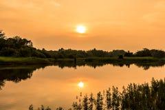 Landskapsikt med solnedgångtider Arkivfoto